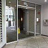 Entry glass doors supply and installation for hi rise apartment building Vancouver downtown