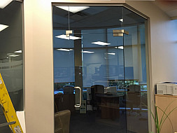 Custom 135 degree glass doors system for office