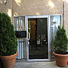 entrance, aluminum swinging door with glass for residential apartment building