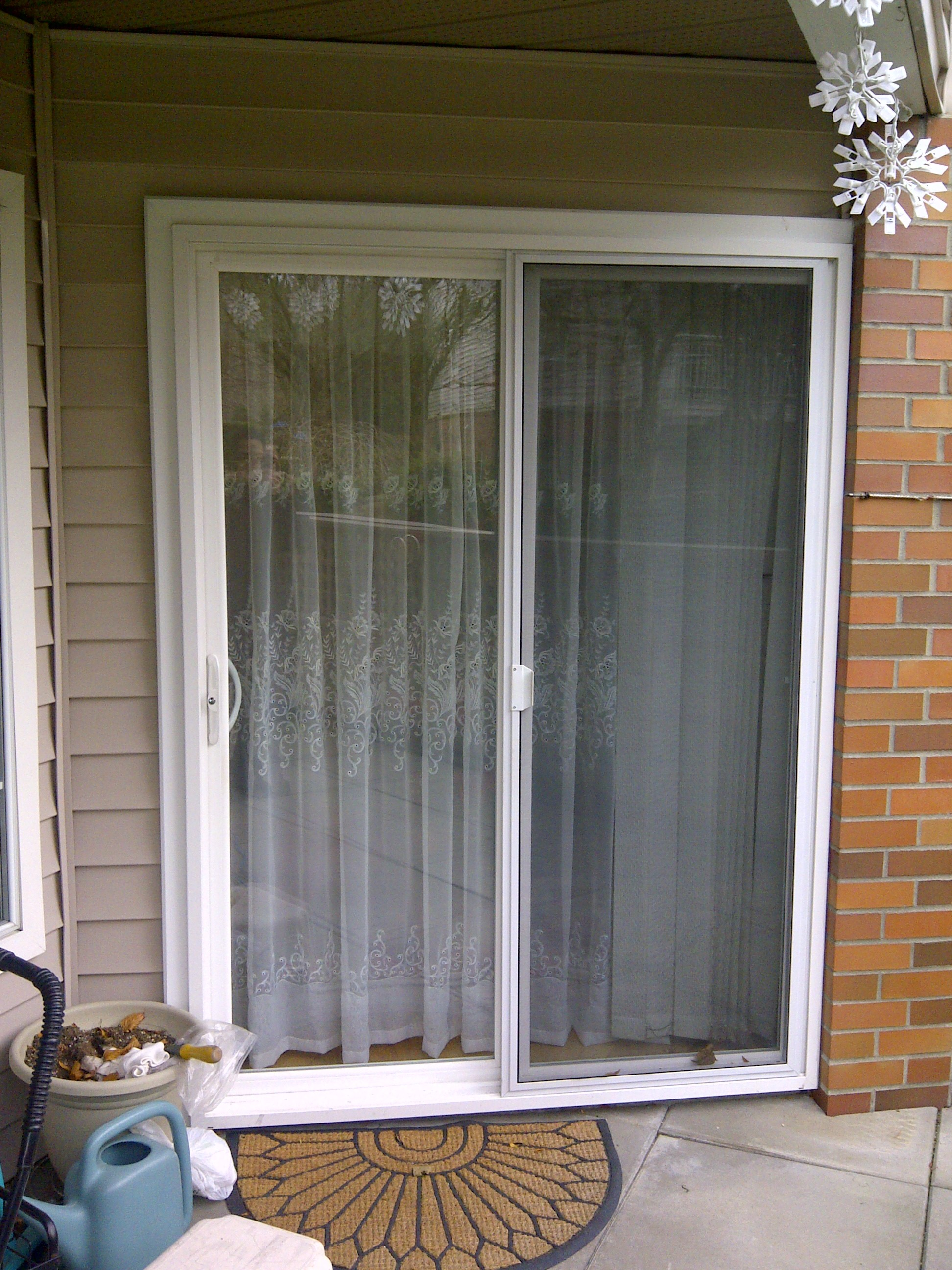 Commercial glass canopy repair in vancouver b c for Small sliding glass patio doors