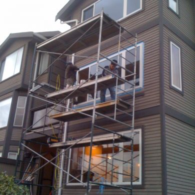 Burnaby home window installation. New sliding window installation job required scaffolding. After new window installation home is much warmer in winter.