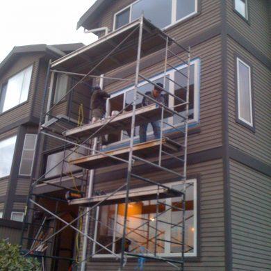 Burnaby home window installation. New sliding window installation job required scaffolding. After new window installation home is much warmer in winter.