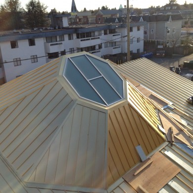 Installed large custom design and custom sized glass skylight system onto a custom built buddhist temple roof top commercial building. The aluminum skylight system are custom built in our shop and were installed onsite by our installers. its in vancouver