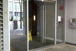 Entry glass doors supply and installation for hi rise apartment building Vancouver downtown.