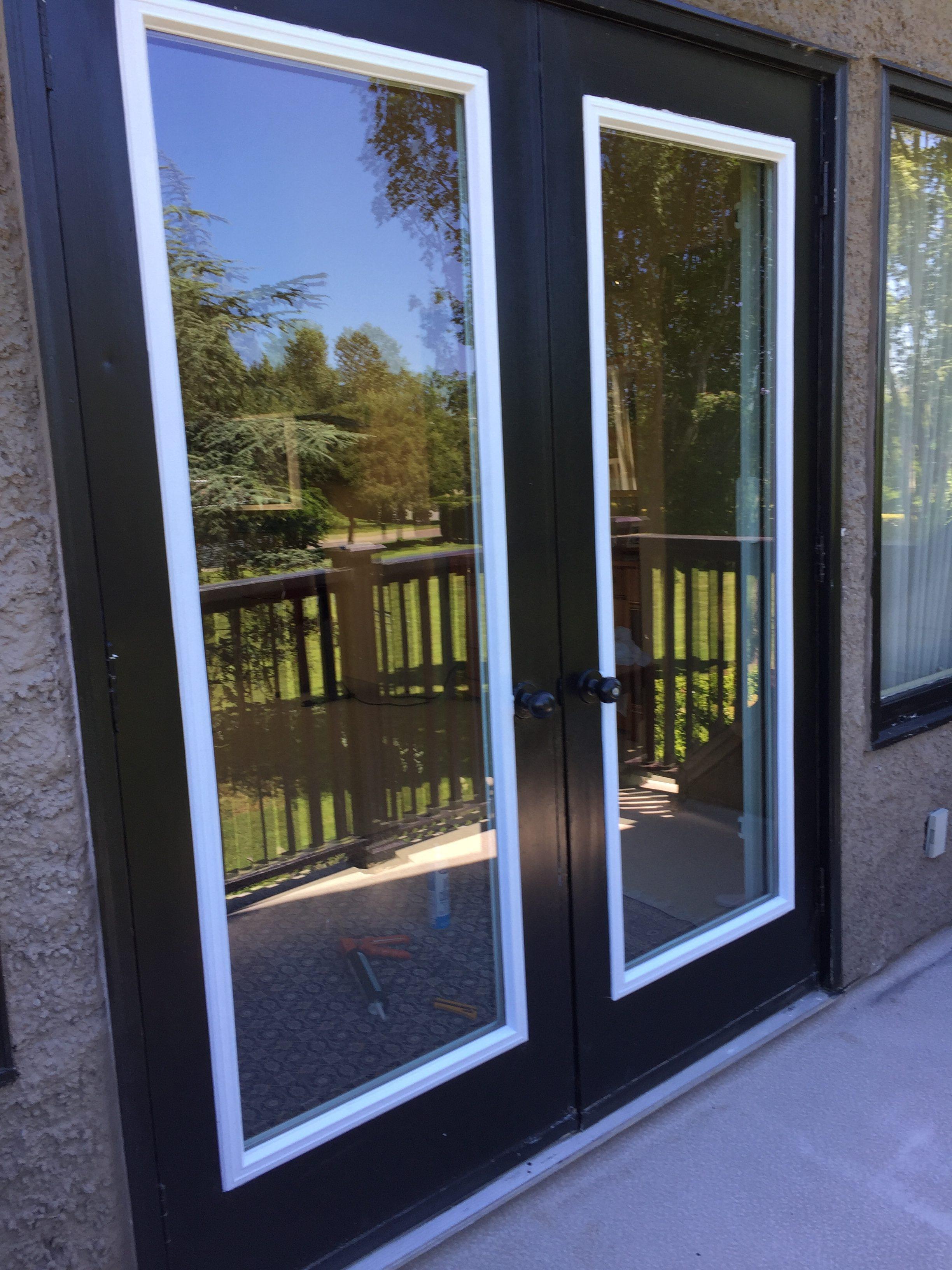 78105 new aluminum glass swinging door insert installed outside view