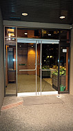 New elegant frameless glass doors system for hi rise apartment building.  Door handles from inside are push panic for emergency exit access
