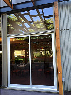 Commercial sliding aluminum door with top glass tramsom