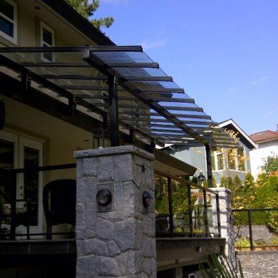 Custom built large deck GLASS AND ALUMINUM CANOPY SYSTEM with custom powder coated gloss black aluminum frames