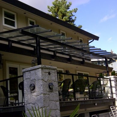 Installed custom built aluminum canopy system with safety glass