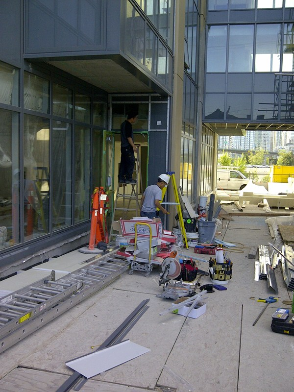 installation of new curtain wall window frame and entry door