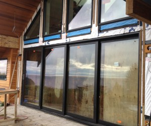 Installed brand new large oversized aluminum sliding glass door system into a residential home in West Vancouver. This door comes with thermally broken frames and double pane glass which makes it energy efficient while the sheer size of the doors gives the back of the home maximum ocean views.