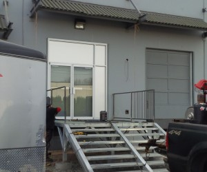 New commercial aluminum entry doors with glass installation.